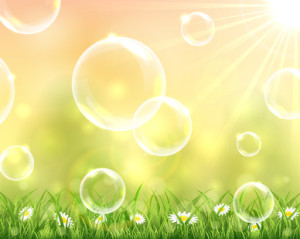 Bubbles flying over the grass