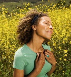 Happy Woman in Meadow --- Image by © Patrik Giardino/Corbis